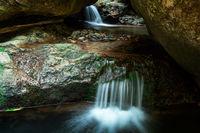Waterfall flow through cavern