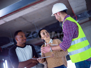 multiethnic business people,architect and engineer on construction site
