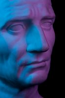 Gypsum copy of ancient statue Augustus head isolated on black background. Plaster sculpture man face.