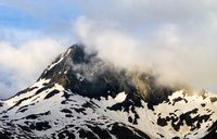 Clouds Pass By a Snow Mountain Top