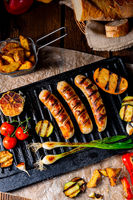 Delicious  grilled sausage with various grilled vegetables