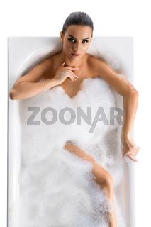 Gorgeous brunette in foam bath shot