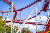 Rollercoaster in red colors with curves and loops