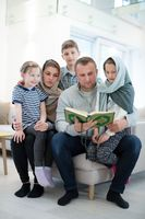 portrait of young happy modern muslim family