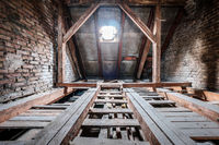 floor beams in empty attic / loft of an old building roof -