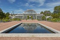 Greenhouse reflection and Kaisaniemi botanic garden in Helsinki Finland