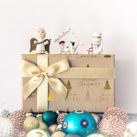 Christmas decoration with wooden figures glass balls and gift box