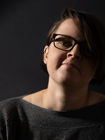 young woman with glasses portrait