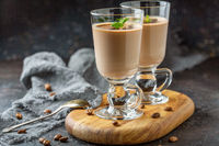 Coffee Panna cotta on milk chocolate in beautiful glasses.