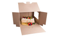 cake with berries in box isolated