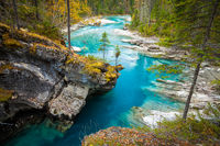 Turquoise blue river flowing through a canyon in the forest