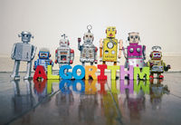 ALGORITHM wooden letters and retro robot toys