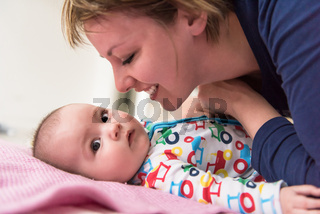young mother kissing her cute little baby
