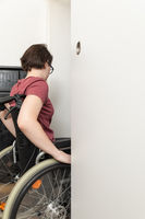 disabled woman at the open door