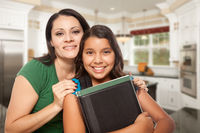 Proud Hispanic Mother and Daughter In Kitchen at Home Ready for School