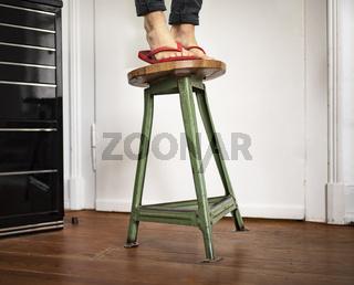 Man falls off the stool