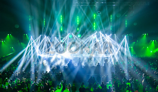Stage illuminated by beautiful rays of lighting equipment.