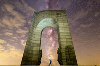 The Arch of Freedom monument Purple Milky way falling stars