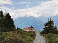 Man and Woman sitting looking the Nature viewpoint on mountain