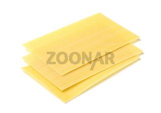 Three uncooked  lasagne sheet
