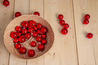 Red Christmas balls scattered on the wooden floor. Christmas decorations.