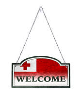 Tonga welcomes you! Old metal sign isolated