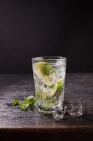 Citrus lemonade lemon cocktail on dark background