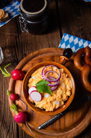 rustic Bavarian obazda with radishes and onions
