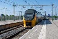 Train arriving at central station Lelystad, the Netherlands