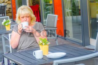 Blond woman, coffee, sidewalk cafe