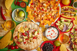 An overhead photo of an assortment of many different Mexican foods on a table