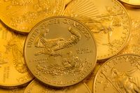 Pile of US Treasury Gold Eagle one ounce coins