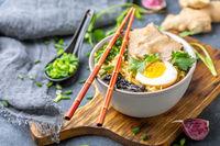Ramen noodles with pork and pickled egg.
