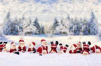 Santas in front of winter landscape