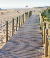 Wooden walkway, people, beach, church