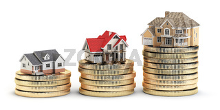 Different size houses with different value on stacks of coins. Concept for property, mortgage and real estate investment.
