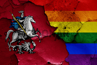 flags of Moscow and LGBT painted on cracked wall