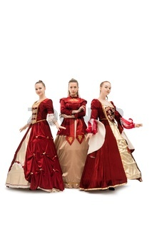 Three girls in gorgeous queen red dresses