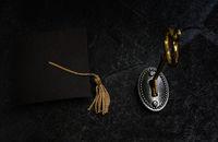 Gold key and grad cap