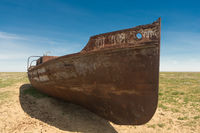 an old ship on land. at the bottom of the dried Aral sea