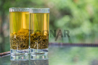 Two glasses of green tea on a table