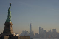 The Statue of Liberty in front of the skyline of New York