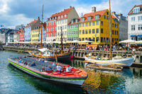 Touristic boat cruising by Nyhavn