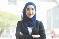 Muslim woman in business suit.