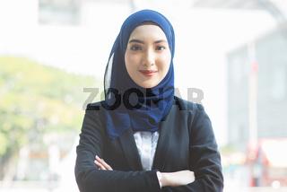 Muslim woman in business suit.