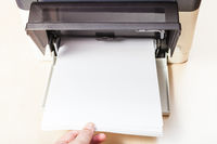 putting of white paper sheets in printer tray