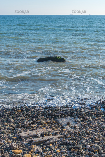 Lonely stone in the sea at the coast