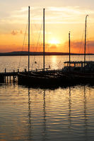 moored sailboat boats at sunset over lake Steinhuder Meer in Germany
