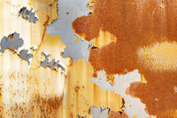 Rostiges Metall mit abgeblätterter Farbe als Hintergrund