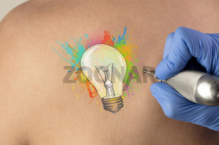 Tattooing idea concept on naked back